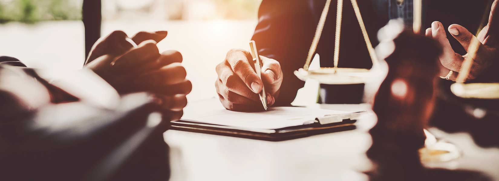 lawyer and client reviewing a car accident case