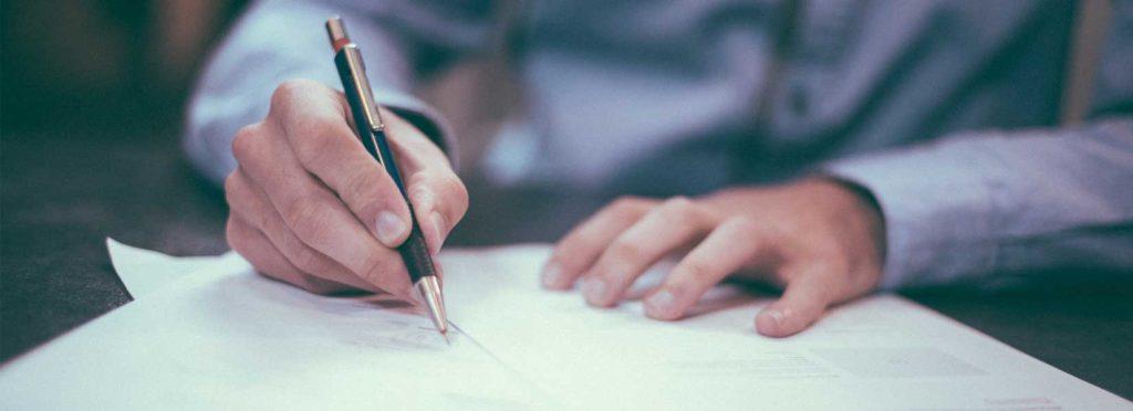 man writing a claim