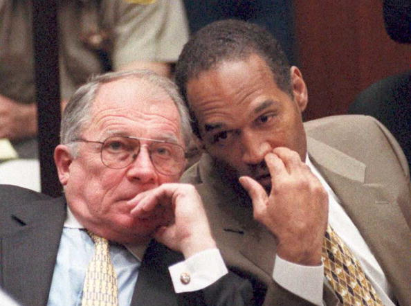 OJ Simpson whispering to F. Lee Bailey