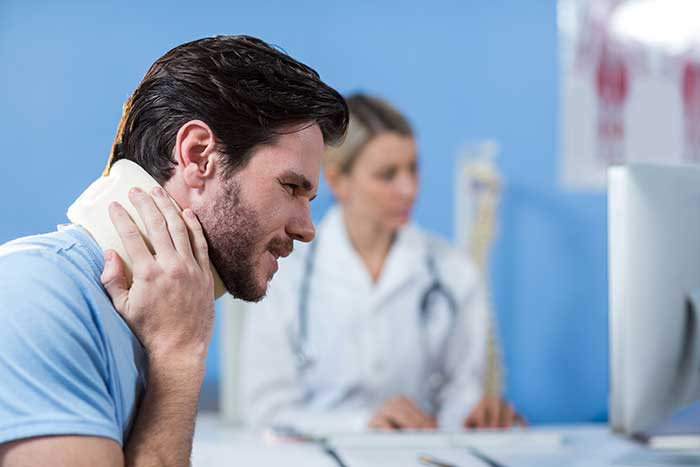 A person with neck injury in a doctors office in Arizona