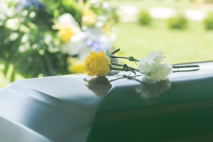 flowers on top of a coffin