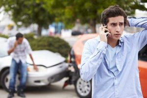 Driver in Surprise calling someone after a car accident