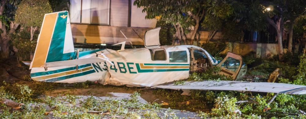 This image shows a small private plane crashed in a residential area.