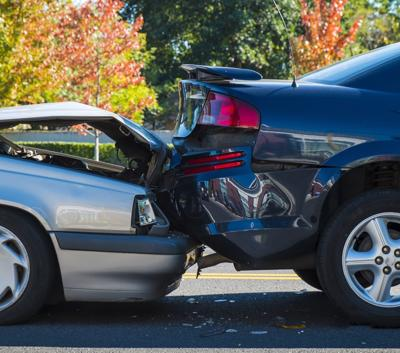 Two cars are shown after a rear end collision