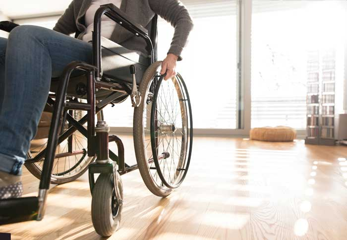 Woman on a wheelchair due to a paralysis injury
